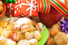 Dish, cookies, gifts and Christmas balls Stock Photography