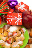 Dish, cookies, gifts and Christmas balls Royalty Free Stock Image