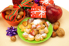 Dish, cookies, gifts and Christmas balls Stock Photo