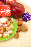 Dish, cookies, gifts and Christmas balls Royalty Free Stock Photos