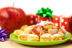 Dish, cookies, gifts and Christmas balls Stock Photos