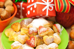 Dish, cookies, gifts and Christmas balls Royalty Free Stock Photo