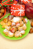 Dish, cookies, gifts and Christmas balls Stock Image