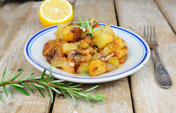 Dish from country style roasted potatoes Royalty Free Stock Photo