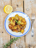Dish from country style roasted potatoes Stock Photo