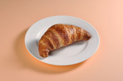 Dish with a croissant Stock Photos