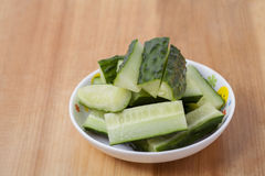 A dish cucumber. Diced cucumber on the plate Royalty Free Stock Images