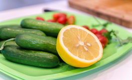 Dish with cucumber , tomato and lemon Royalty Free Stock Photography