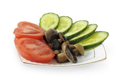 Dish of cucumbers, tomatoes and pickled mushrooms Royalty Free Stock Photography