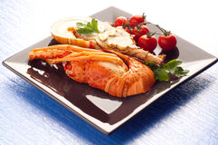 Dish with cut lobster Stock Photography