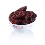 A dish of dates isolated Stock Images