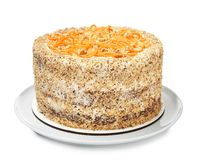 Dish with delicious carrot cake on white. Background royalty free stock images