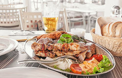 A dish of different meats - beef, pork, chicken, Turkey and grilled vegetables Stock Image