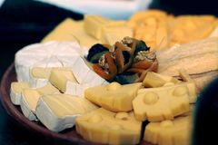 Dish of diverse cheeses. Dish of various cheeses with dried fruits Royalty Free Stock Images