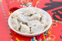 A dish of dumplings under the background of red couplets during the Spring Festival stock images