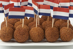 Dish with Dutch traditional snack bitterballen with a dutch flag Stock Photography