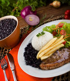 Dish executive: Picanha, fires, rice and beans. Meal typical of Brazil Royalty Free Stock Photography