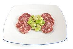 Dish with fava beans and salami Royalty Free Stock Photo