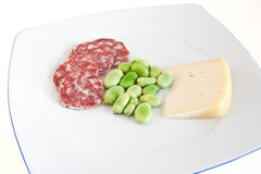 Dish with fava beans and salami Royalty Free Stock Image