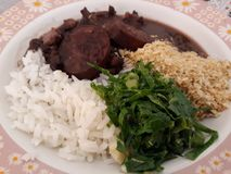 Dish with feijoada with farofa and cabbage royalty free stock images