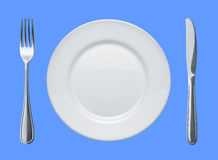 Dish and flatware. On blue background royalty free stock photo