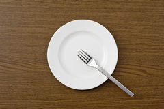 Dish and fork Stock Images