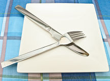 Dish with fork and knife Royalty Free Stock Photo