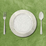Dish fork and knife recycled paper.  Royalty Free Stock Image
