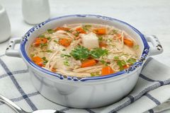 Dish with fresh homemade chicken soup served on table. Closeup stock photo