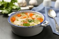Dish with fresh homemade chicken soup. On table stock image
