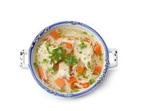 Dish with fresh homemade chicken soup on white background. Top view stock photography