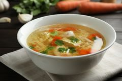 Dish with fresh homemade chicken soup on table. Dish with fresh homemade chicken soup on wooden table royalty free stock photography