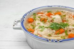 Dish with fresh homemade chicken soup on wooden table. Closeup. Space for text stock photography