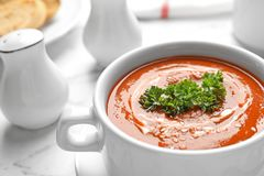 Dish with fresh homemade tomato soup on table, closeup. Space for text royalty free stock image