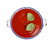 Dish with fresh homemade tomato soup on white, top view. Dish with fresh homemade tomato soup on white background, top view royalty free stock photos