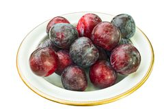 Dish of fresh plums on white background Royalty Free Stock Image