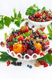 Dish with fresh seasonal fruit and berries, vertical Stock Photo