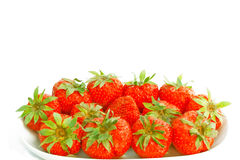 Dish of fresh strawberries with stalks Royalty Free Stock Photos