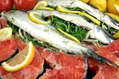 Dish With Fresh  Stuffed Fish And Salmon Steak. Dish With Fresh  Stuffed Fish Salmon Steaks,  Lemon Slice And Herbs Royalty Free Stock Photo