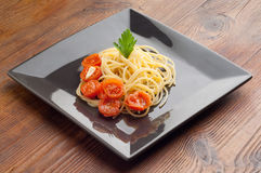Dish with fresh tomatoes  spaghetti Stock Photo