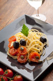 Dish with fresh tomatoes  spaghetti Stock Photography