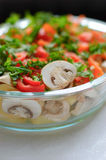 Dish of fresh vegetables. And mushrooms Stock Photography