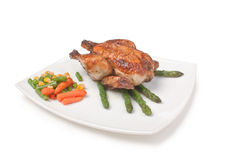 Dish of fried chicken with vegetables Royalty Free Stock Photo