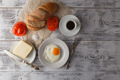 Dish of fried eggs with bread Royalty Free Stock Image