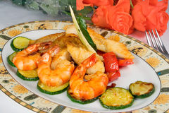 Dish: fried fish fillets, shrimp, zucchini Stock Photos