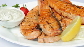 Dish of fried fish.Trout steak with sauce. stock video