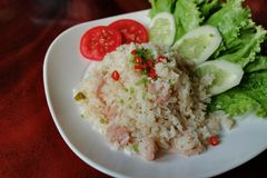 A dish of fried rice with sour pork Stock Photo