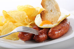 Dish of fried sausages isolated Stock Images