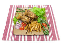 Dish with fried woodcock and vegetables on a napkin on white bac Royalty Free Stock Image