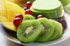Dish of fruit. Dish of mango, grape, kiwi, green apple Stock Photography